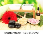 cosmetic clay for spa treatments on bright green background close-up - stock photo