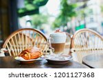 cup of coffee and fresh pastry... | Shutterstock . vector #1201127368