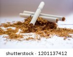Small photo of View of the cigarettes and tobacco. Tobacco use is a risk factor for many diseases, especially those affecting the heart, liver, and lungs, as well as many cancers.