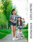 mother teaching her daughter... | Shutterstock . vector #1201148782