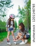 mother teaching her daughter...   Shutterstock . vector #1201148785