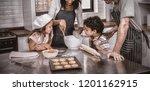 happy family cooking biscuits... | Shutterstock . vector #1201162915