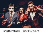 young people in costumes... | Shutterstock . vector #1201174375