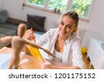 woman drawing activity at her... | Shutterstock . vector #1201175152