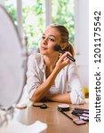 woman using makeup | Shutterstock . vector #1201175542