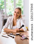 woman trying out new make up at ... | Shutterstock . vector #1201175545