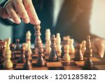 business man moving chess... | Shutterstock . vector #1201285822