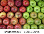 Green and red apples at the greengrocer - stock photo