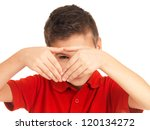 Young boy looking through heart shape - isolated on white background - stock photo