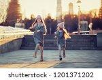 two happy children running on... | Shutterstock . vector #1201371202