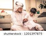 happy arabian family having fun ... | Shutterstock . vector #1201397875