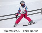 Girl on the ski competition - stock photo