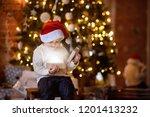 cute little boy wearing santa...   Shutterstock . vector #1201413232