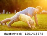 little boy and his father doing ... | Shutterstock . vector #1201415878