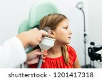 young girl at medical... | Shutterstock . vector #1201417318