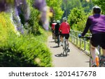 sportive middle age man cycling ... | Shutterstock . vector #1201417678