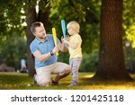 father and his son playing...   Shutterstock . vector #1201425118