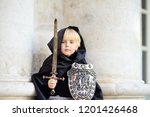portrait of a cute little boy... | Shutterstock . vector #1201426468