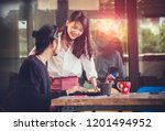 young asian man and woman... | Shutterstock . vector #1201494952