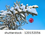Red Christmas Ball On A Snow...