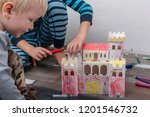 happy boys build vintage... | Shutterstock . vector #1201546732