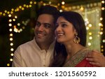 young couple smiling while... | Shutterstock . vector #1201560592