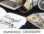 frugal living written on a note ... | Shutterstock . vector #1201562095