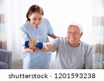 young female nurse helping... | Shutterstock . vector #1201593238