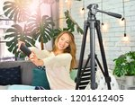 blogging concept. girl makes... | Shutterstock . vector #1201612405