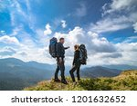 the couple on the mountain on... | Shutterstock . vector #1201632652
