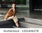 young businesswoman sitting... | Shutterstock . vector #1201646278