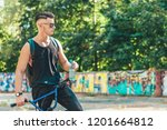 young cyclist in sunglasses and ... | Shutterstock . vector #1201664812