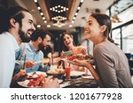 Stock photo group of happy friends having breakfast in the restaurant 1201677928