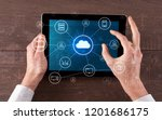hand touching tablet with cloud ... | Shutterstock . vector #1201686175