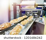 packing machine with a roll of... | Shutterstock . vector #1201686262