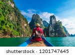 man traveler on boat joy... | Shutterstock . vector #1201747645