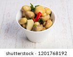 tasty salty pickled mushrooms... | Shutterstock . vector #1201768192