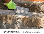 bricklayer making a new wall | Shutterstock . vector #1201786138