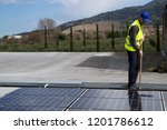 fitting photovoltaic panels on... | Shutterstock . vector #1201786612
