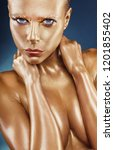 gilded body. golden makeup.... | Shutterstock . vector #1201855402