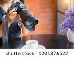 woman photographer holding... | Shutterstock . vector #1201876522