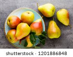 fresh bio pear with leaves on... | Shutterstock . vector #1201886848
