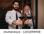winemakers in wine cellar... | Shutterstock . vector #1201898908