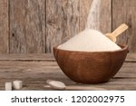 sugar bowl over wooden table | Shutterstock . vector #1202002975