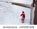 child playing with snow in... | Shutterstock . vector #1202087608