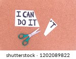 cutting the word in paper note... | Shutterstock . vector #1202089822