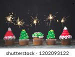 vanilla cupcakes with christmas ... | Shutterstock . vector #1202093122