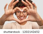 close up shot of cheerful... | Shutterstock . vector #1202142652