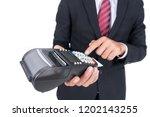 businessman holds payment... | Shutterstock . vector #1202143255