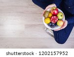 girl holding white plate with... | Shutterstock . vector #1202157952
